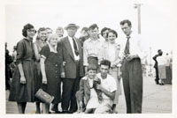 "Damiano Family with Giuseppe ""Joe"" kneeling in white shirt and father ""Mastro Antonio"" with hat"