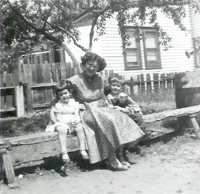 Roseanne McKeever with her mom Rose and brother Mike in their Grandparent's backyard on Franklin Street in Trenton, NJ, circa 1955